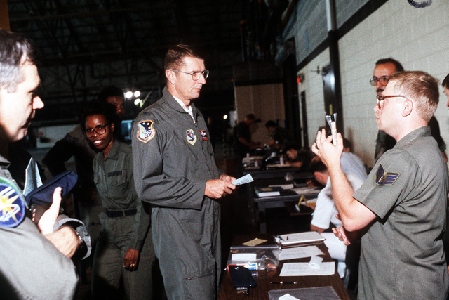 An air crew member receives instructions on chemical warfare antidote prior to deploying to Saudi Arabia in support of Operation Desert Shield