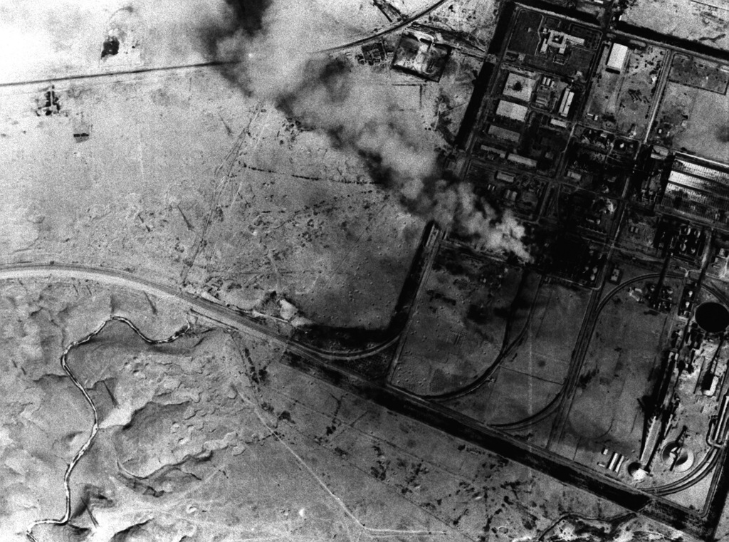 An overhead view of the A1 Qaim superphosphate fertilizer plant, showing some of the damage caused by Allied bombing attacks during Operation Desert Storm. Some structures are still burning as a result of the most recent attack. The photograph was taken from a Fighter Squadron 32 (VF-32) F-14A Tomcat aircraft using the tactical air reconnaissance pod system (TARPS)