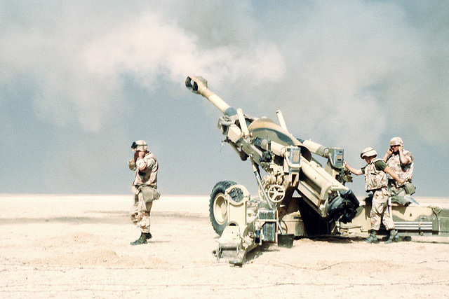Marine artillerymen from the 2nd Marine Expeditionary Force fire their M-198 155mm howitzer in support of the opening of the ground offensive to free Kuwait during Operation Desert Storm