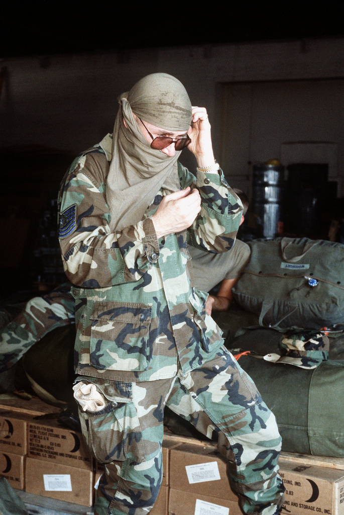 MASTER SGT. Dennis Sprong, 375th Supply Squadron, tries on head gear in preparation for deploying to Saudi Arabia in support of Operation Desert Shield