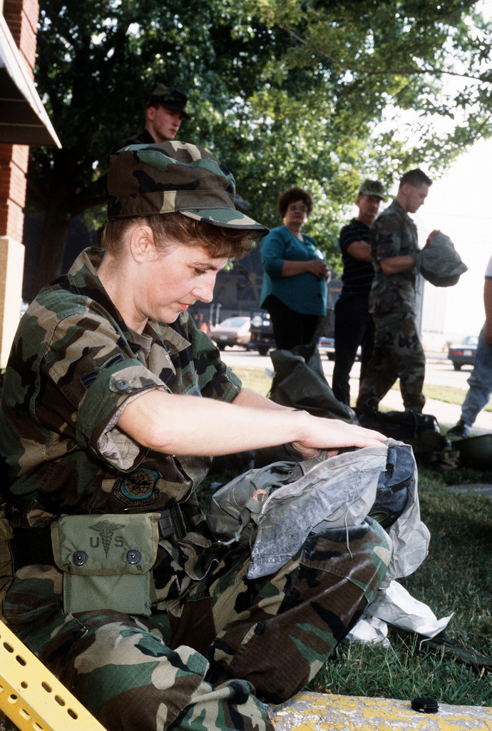 MASTER SGT. Patsy Johnson, 375th Combat Support Group, packs her gas mask prior to deploying to Saudi Arabia in support of Operation Desert Shield