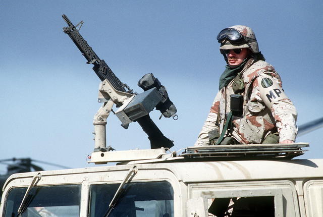 Marine Lance CPL. Patrick Ericson mans an M-60 general-purpose machine gun mounted on an M-998 high-mobility, multipurpose, wheeled vehicle at Kuwait International Airport after the retreat of Iraqi forces from Kuwait during Operation Desert Storm.