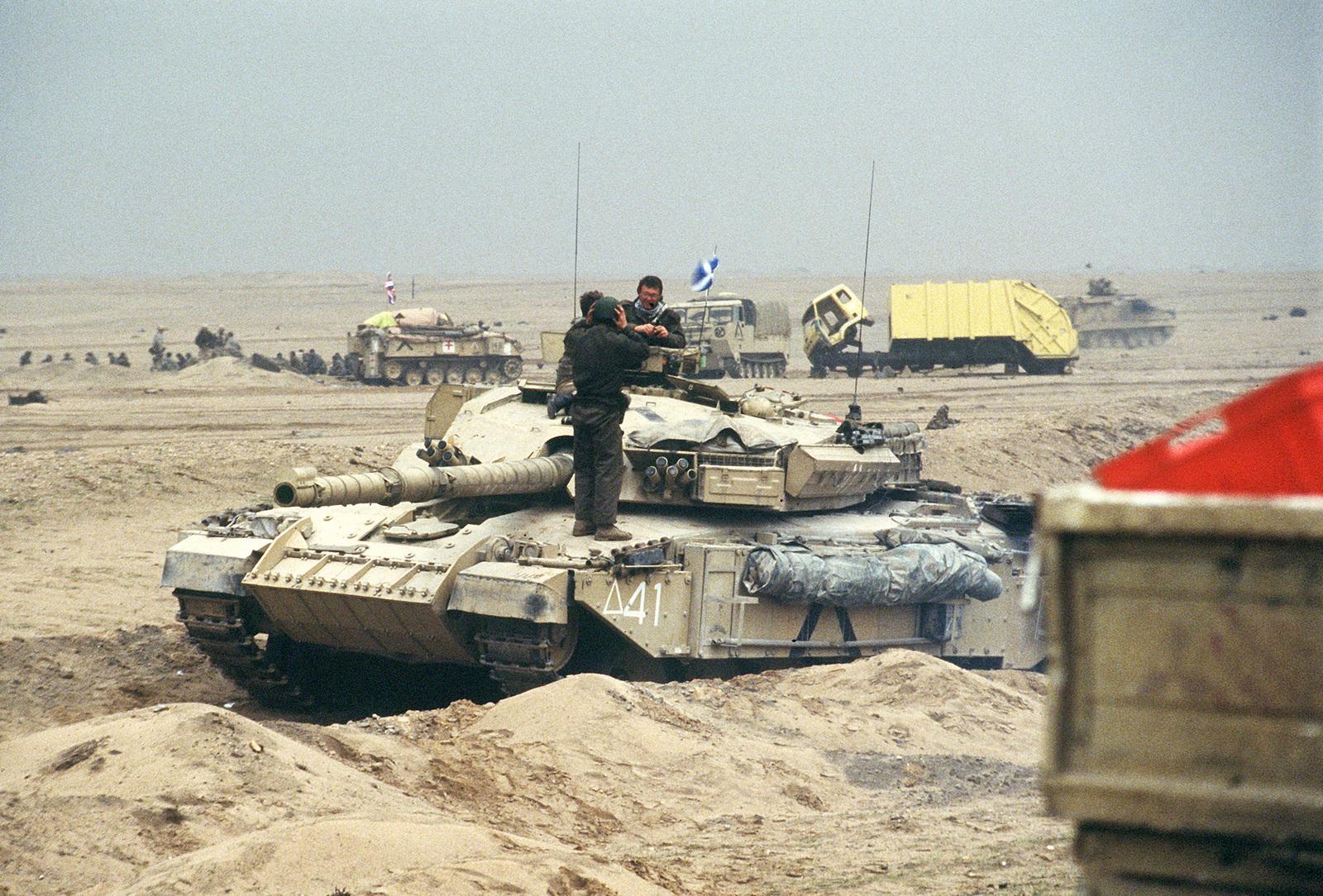 cffb622eeeb9 A British Challenger main battle tank waits by the Basra-Kuwait Highway  near Kuwait City following ...