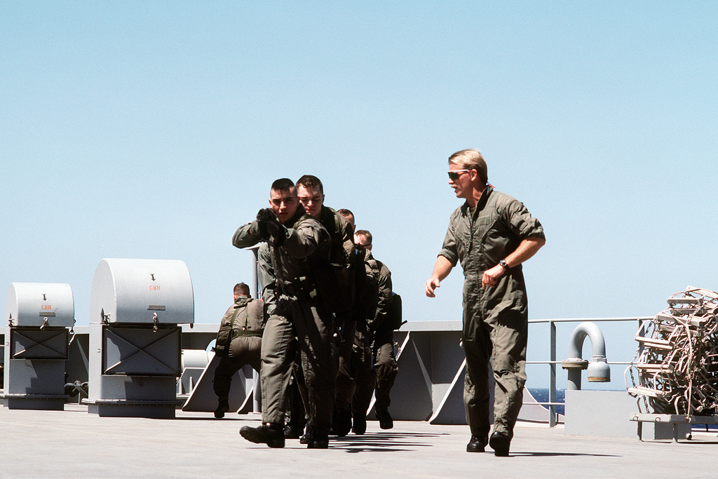 A member of Sea-Air-Land (SEAL) Team 8 leads members of the