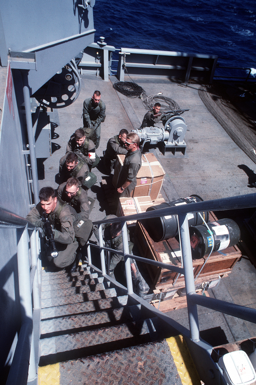 A member of the Sea-Air-Land (SEAL) Team 8, center, looks on
