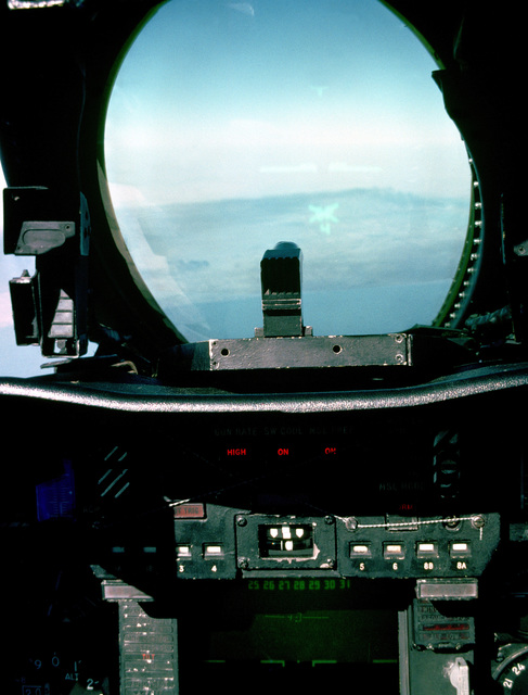 A view from the cockpit of a Fighter Squadron 33 (VF-33) F-14A Tomcat aircraft as it approaches the Kuwaiti coastline following Operation Desert Storm. VF-33 is embarked aboard the aircraft carrier USS AMERICA (CV 66).