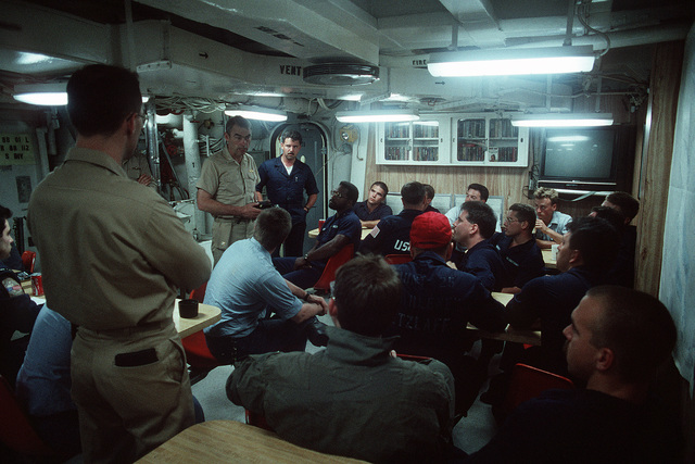 CAPT. Douglas C. Bauer, a Naval historian, questions crew members aboard the guided missile destroyer USS WILLIAM V. PRATT (DDG-44), flagship of the Maritime Interdiction Force. Bauer is recording information regarding the role of the PRATT and its crew in enforcing U.N. trade sanctions against Iraq during Operation Desert Storm