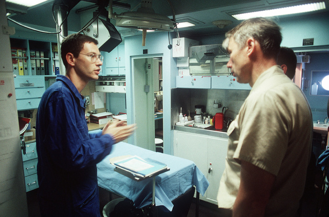 CAPT. Douglas C. Bauer, a Naval historian, speaks with the ship's doctor during a tour of the sick bay aboard the French destroyer FS JEAN DE VIENNE (D-643). The French ship, part of the Maritime Interdiction Force, has been assisting in the enforcement of U.S. trade sanctions against Iraq during Operation Desert Storm