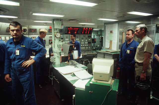 CAPT. Douglas C. Bauer, a Naval historian, tours the engine room of the French destroyer FS JEAN DE VIENNE (D-643) with the ship's commanding officer during a visit aboard the vessel. The French ship, part of the Maritime Interdiction Force, has been assisting in the enforcement of U.S. trade sanctions against Iraq during Operation Desert Storm