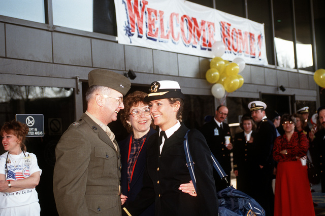 MAJ. GEN. Gene Deegan, vice director of the Joint Chiefs of STAFF Committee, and his wife, Nancy, welcome their daughter, ENSIGN Elizabeth Deegan, at a homecoming party at the Bethesda Naval Medical Center. The celebration is being held in honor of the crew members of the hospital ship USNS COMFORT (T-AH-20) who served in the Persian Gulf during Operation Desert Storm