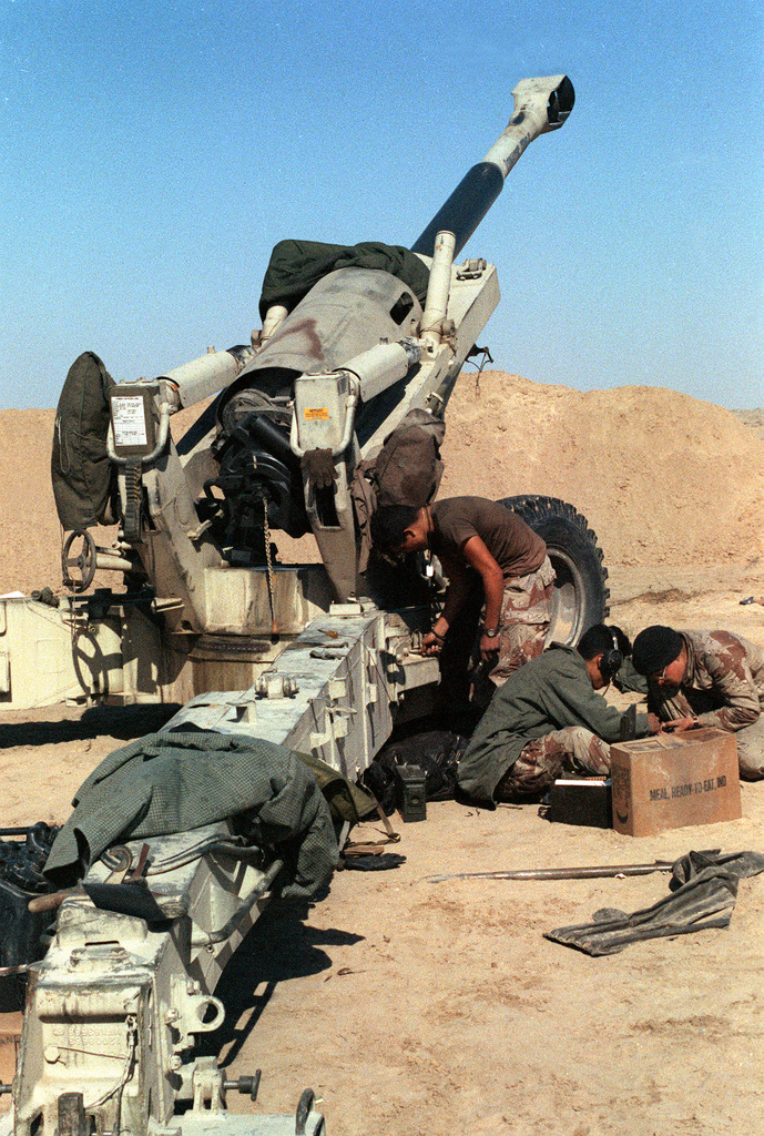 Marines from Btry. E, 2nd Bn., 10th Marines. perform preventive maintenance on their M-198 155mm howitzer following Operation Desert Storm.
