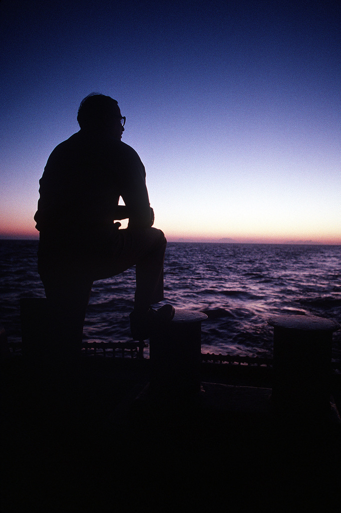 SENIOR CHIEF Machinist's Mate Dennis Cutler watches the sun rise over the Sinai Peninsula from the deck of the guided missile destroyer USS WILLIAM V. PRATT (DDG-44). The PRATT, flagship of the Maritime Interdiction Force, has been enforcing U.N. trade sanctions against Iraq during Operation Desert Storm