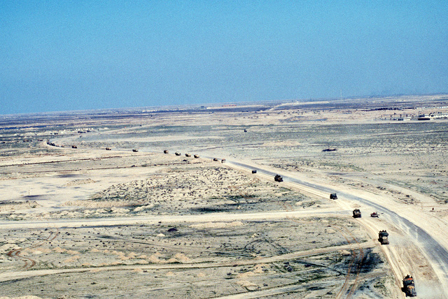 A column of vehicles of the 3rd Armored Regiment moves into the Arramaylan refinery area during Operation Desert Storm.