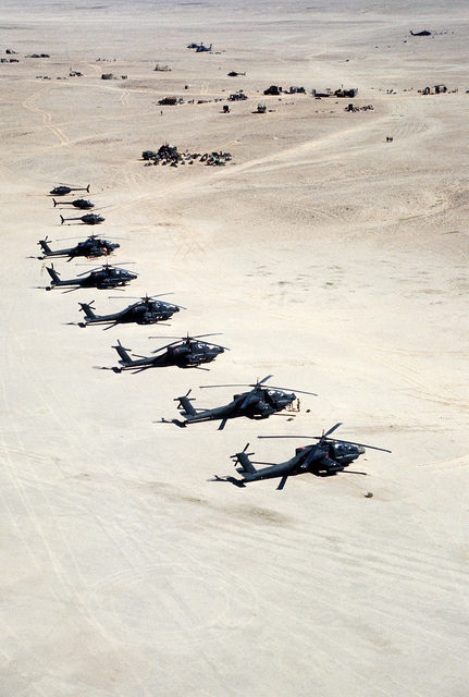 AH-64A Apache advanced attack helicopters of the 101st Airborne Division stand ready at a forward operating base during Operation Desert Storm. Three OH-58D Kiowa Warrior helicopters are behind the Apaches.