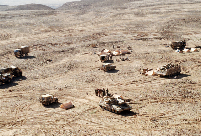 An AMX-30 main battle tank guards an element of the French 6th Light Armored Division Bivouaced outside Al-Salman during Operation Desert Storm.