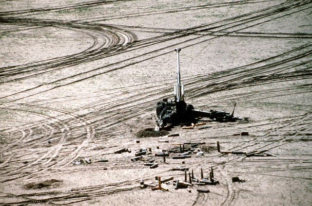 An abandoned Iraqi 155mm G-5 towed howitzer, surrounded by shells and casings, stands near the Arramaylan Refinery in the aftermath of an Allied attack during Operation Desert Storm.