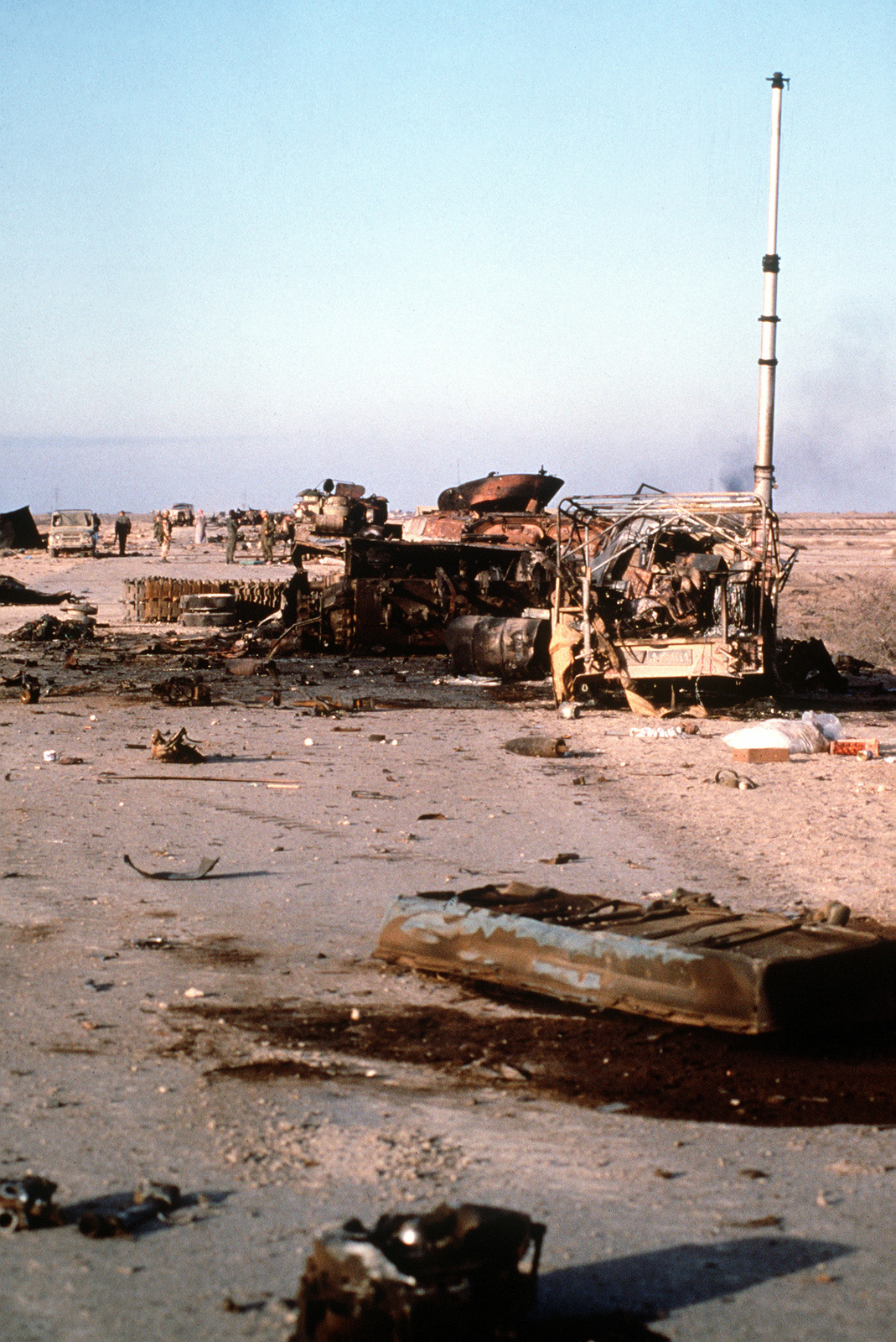 Demolished Iraqi equipment lies on a roadway in the