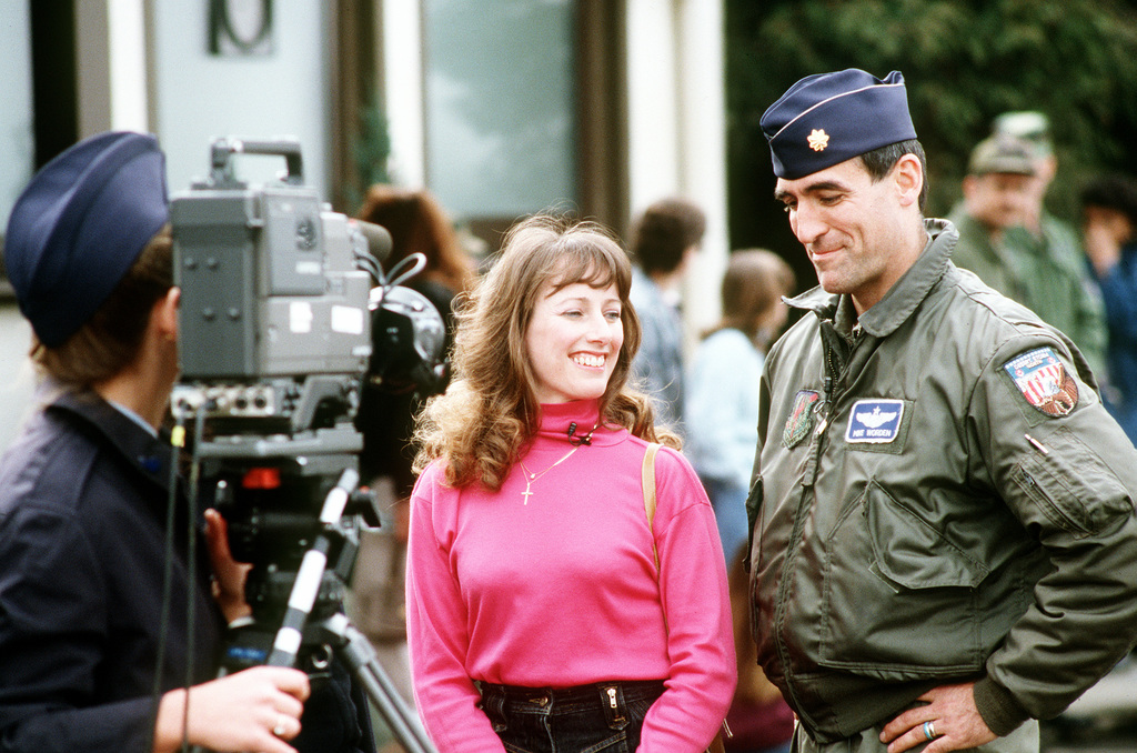 A cameraman videotapes MAJ. Mike Worden and his wife, Lori, following Worden's return from deployment in Incirlik, Turkey during Operation Desert Storm