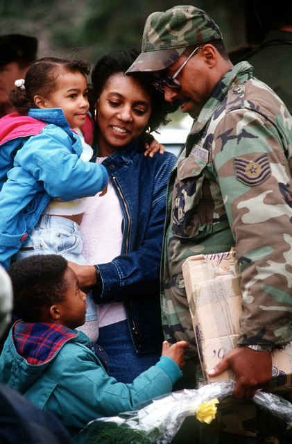 TECH. SGT. James Boles, 52nd Aircraft Generation Squadron, is reunited with his family following his return from deployment in Incirlik, Turkey during Operation Desert Storm