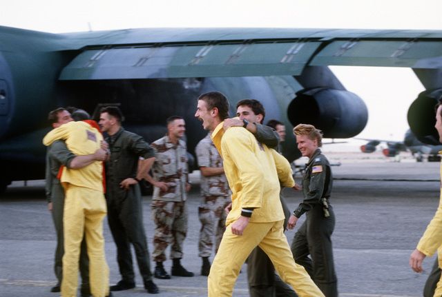 Former prisoner of war CAPT. Richard Storrs, a U.S. Air Force pilot, is greeted by fellow crew members after his arrival at the Riyadh Air Base upon his release by the Iraqi government during Operation Desert Storm.