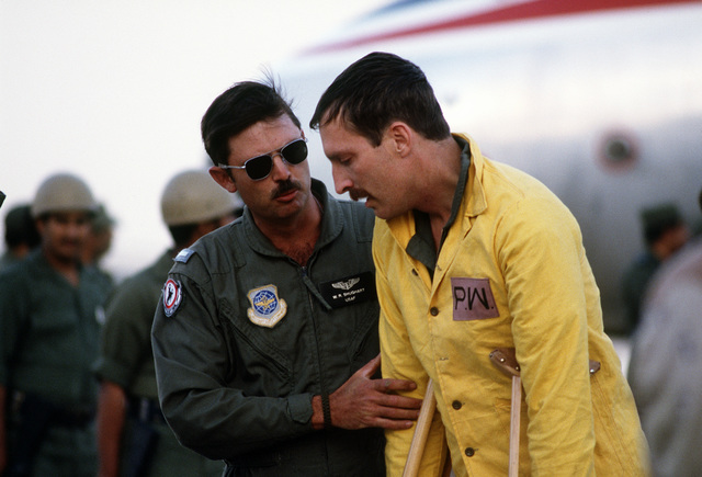 Former prisoner of war CAPT. William Andrews, a U.S. Air Force pilot, is greeted by a fellow crew member after his arrival at the Riyadh Air Base upon his release by the Iraqi government during Operation Desert Storm.