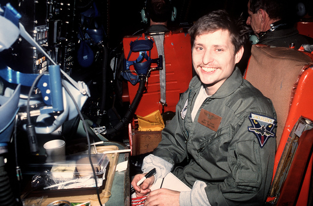 LT. Jeffrey Zahn, a U.S. Navy aviator from Attack Squadron 35 (VA-35), smiles for the camera aboard a C-141B Starlifter aircraft. Zahn, five other Americans and an Italian officer were released after being held as prisoners of war by Iraqi forces during Operation Desert Storm. The former POWs, who were released from captivity on March 4, will receive medical examinations and treatment aboard the hospital ship USNS MERCY (T-SH-19)