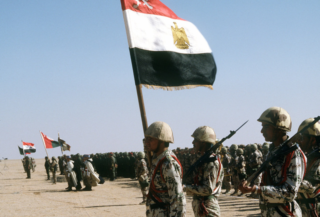Egyptian troops stand ready for review by King Fahd of Saudi Arabia as they take part in an assembly of international coalition forces united against Saddam Hussein during Operational Desert Storm
