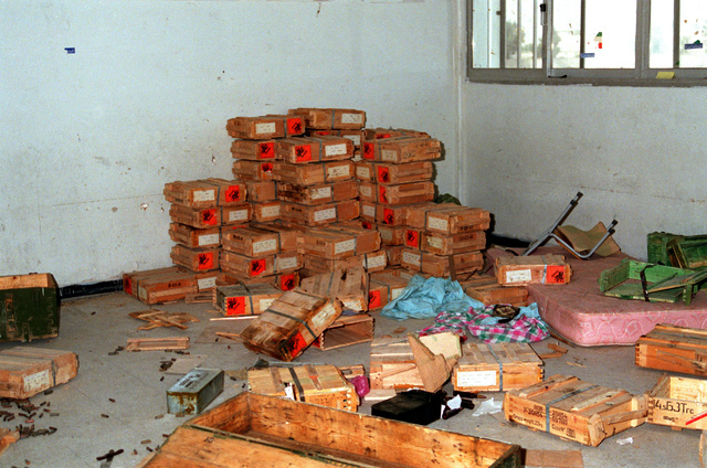 Crates of Iraqi ammunition fill a corner of a room in the A1 Jahra School after the Operation Desert Storm cease-fire