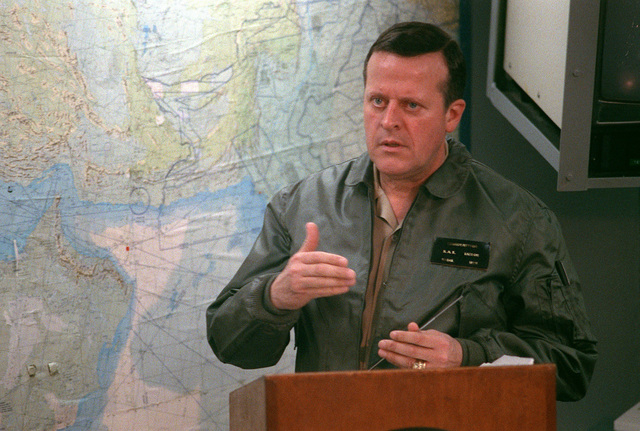 Rear Adm. Raynor A.K. Taylor, commander, Middle East Force, conducts a news conference prior to a ceremony marking the re-opening of Ash Shuaybah's port facility during Operation Desert Storm. The port is being reopened after a multinational effort to clear the mines laid by Iraqi forces during their occupation of Kuwait