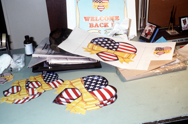 Decorations to be used in welcome home posters cover a table in the graphics section of the 67th Mission Support Squadron. Members of the section are designing posters to greet military personnel returning from deployment in the Persian Gulf area during Operation Desert Storm