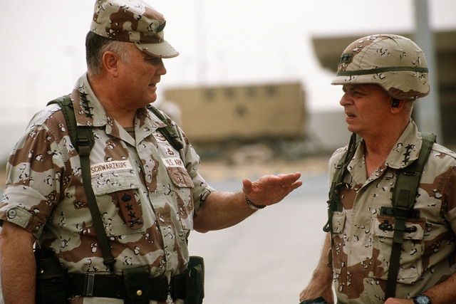 GEN. Norman Schwarzkopf, commander-in-chief, U.S. Central Command, and LT. GEN. Gary Luck, commander, XVIII Airborne Corps, converse prior to Schwarzkopf's departure from the corps' base of operations at Rahfa Airport. Schwarzkopf is visiting the region in the aftermath of Operation Desert Storm.