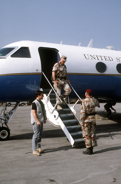 GEN. Norman Schwarzkopf, commander-in-chief, U.S. Central Command, disembarks from a C-20A Gulfstream aircraft as he visits an air base in the aftermath of Operation Desert Storm.