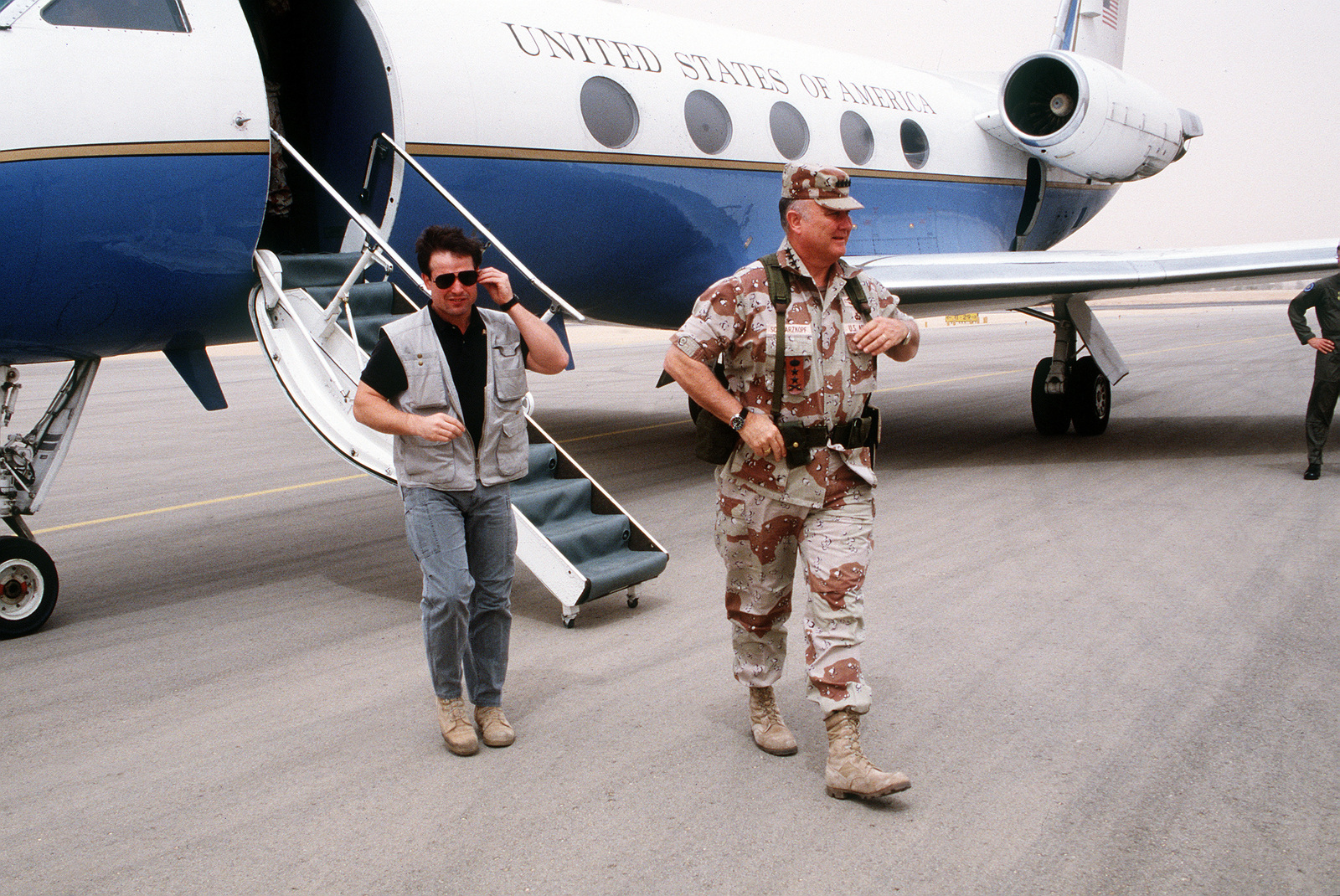 GEN. Norman Schwarzkopf, commander-in-chief, U.S. Central Command, disembarks from a C-20A Gulfstream aircraft as he arrives at the XVIII Airborne Corps base of operations at Rahfa Airport to examine Iraqi aircraft captured during Operation Desert Storm.