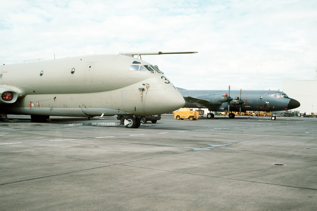 A British Royal Air Force Nimrod Mr. Mark 2 maritime patrol aircraft, foreground, and a Dutch Navy P-3C Orion aircraft sit parked on the ramp