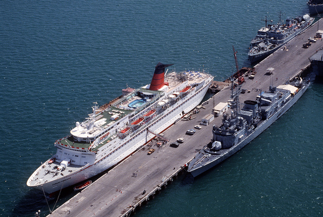 The British ocean liner RMS CUNARD PRINCESS and a French Georges Leygues Class frigate are moored at a pier outside Manama in the aftermath of Operation Desert Storm.