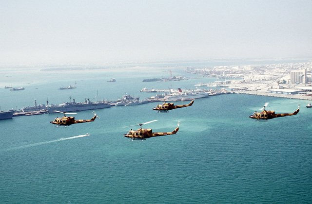 UH-1N Iroquois helicopters fly in formation off the coast of Manama in the aftermath of Operation Desert Storm.