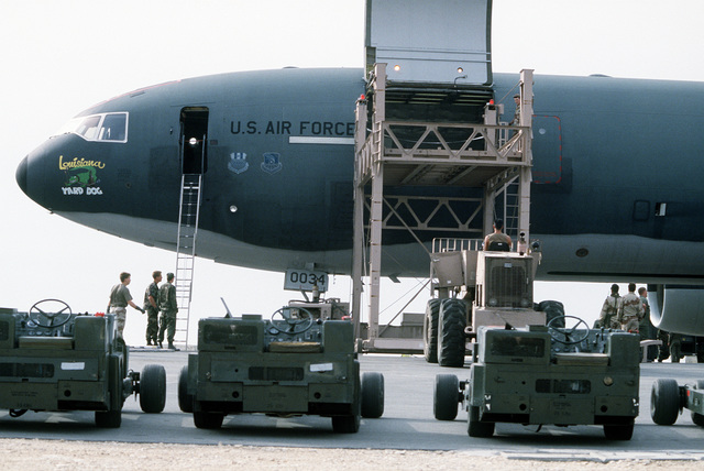 Bomb lifts are loaded aboard a KC-10A Extender aircraft for redeployment to the United States in the aftermath of Operation Desert Storm.