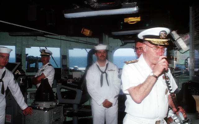 CHIEF of Naval Operations Adm. Frank B. Kelso II uses the ship's internal communication system to speak to the crew of the guided missile frigate USS NICHOLAS (FFG-47) as the ship returns to its home port of Naval Station, Charleston, S.C., following its deployment to the Persian Gulf region for Operation Desert Shield and Operation Desert Storm