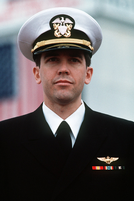 LT. Robert Wetzel stands at attention on the platform during a ceremony held to honor him and two other former prisoners of war. Wetzel, LT. Jeffrey Zaun and LT. Lawrence Slade had been held by Iraq after being shot down during Operation Desert Storm and were among the first group of ten coalition prisoners released on March 4th