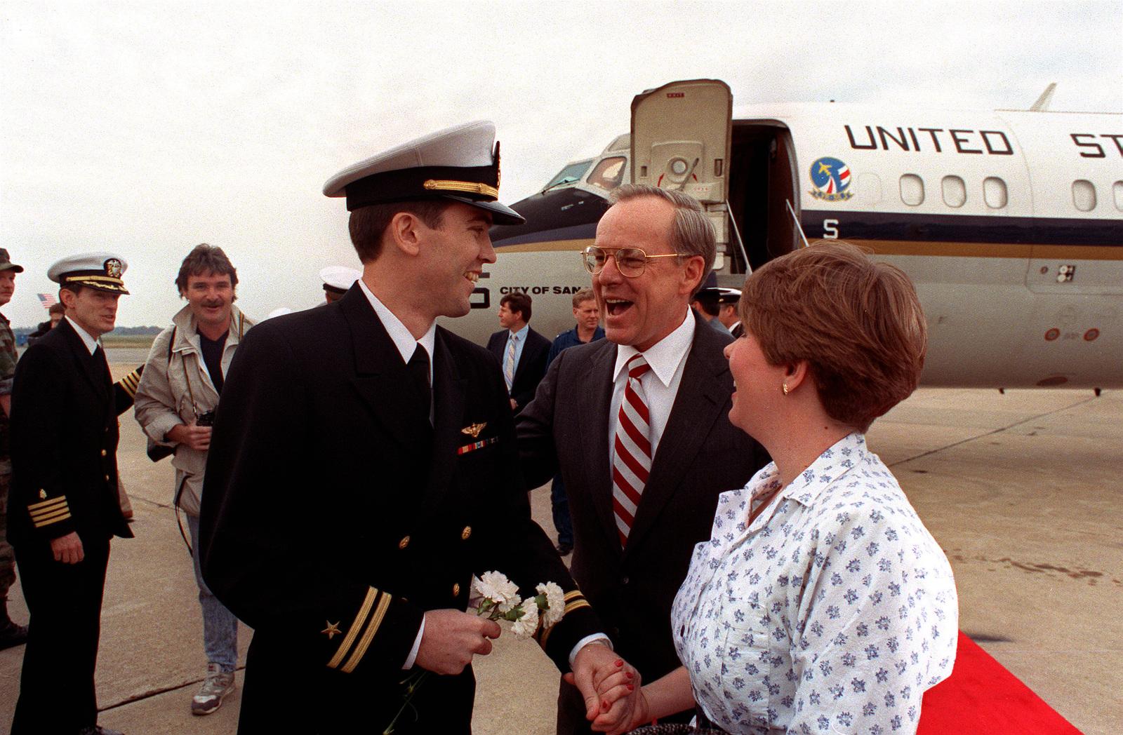 Secretary Of The Navy H Lawrence Garrett Iii Stands Beside Lt