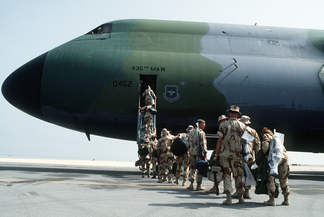 U.S. Marines board a C-5A Galaxy aircraft for redeployment to the United States in the aftermath of Operation Desert Storm.