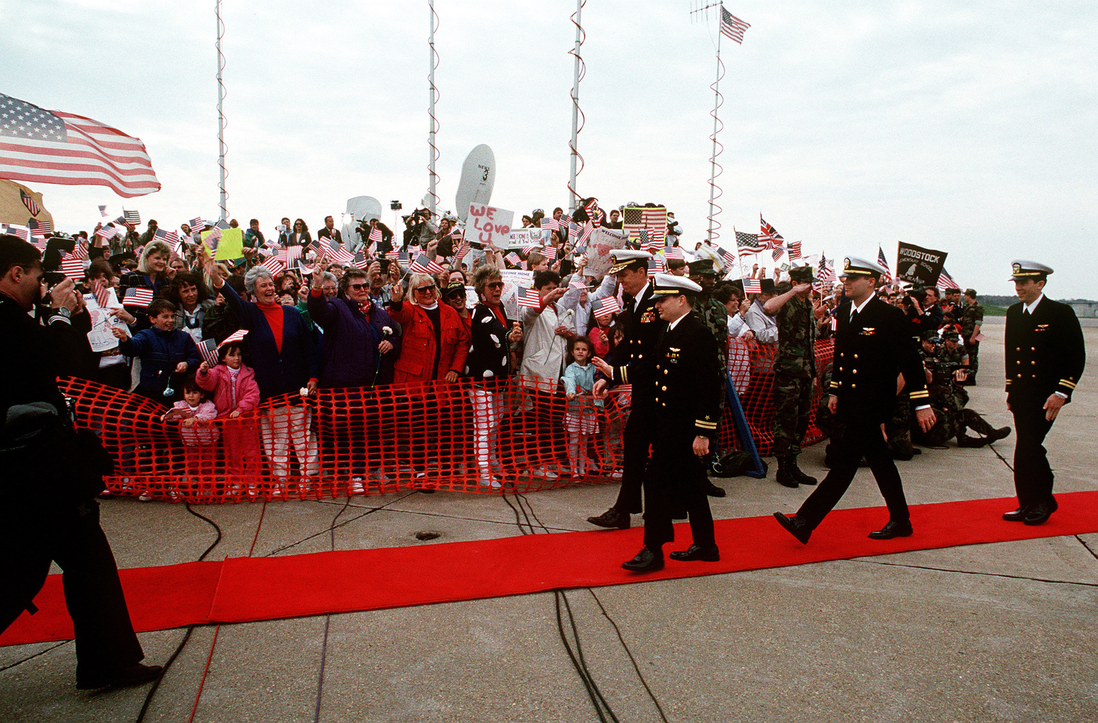 Walking Down A Red Carpet At A Ceremony In Their Honor Are From
