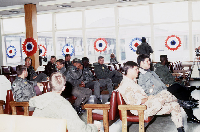 Servicemen relax in a lounge area during a stopover at the air station. The troops are returning from serving in the Persian Gulf during Operation Desert Storm
