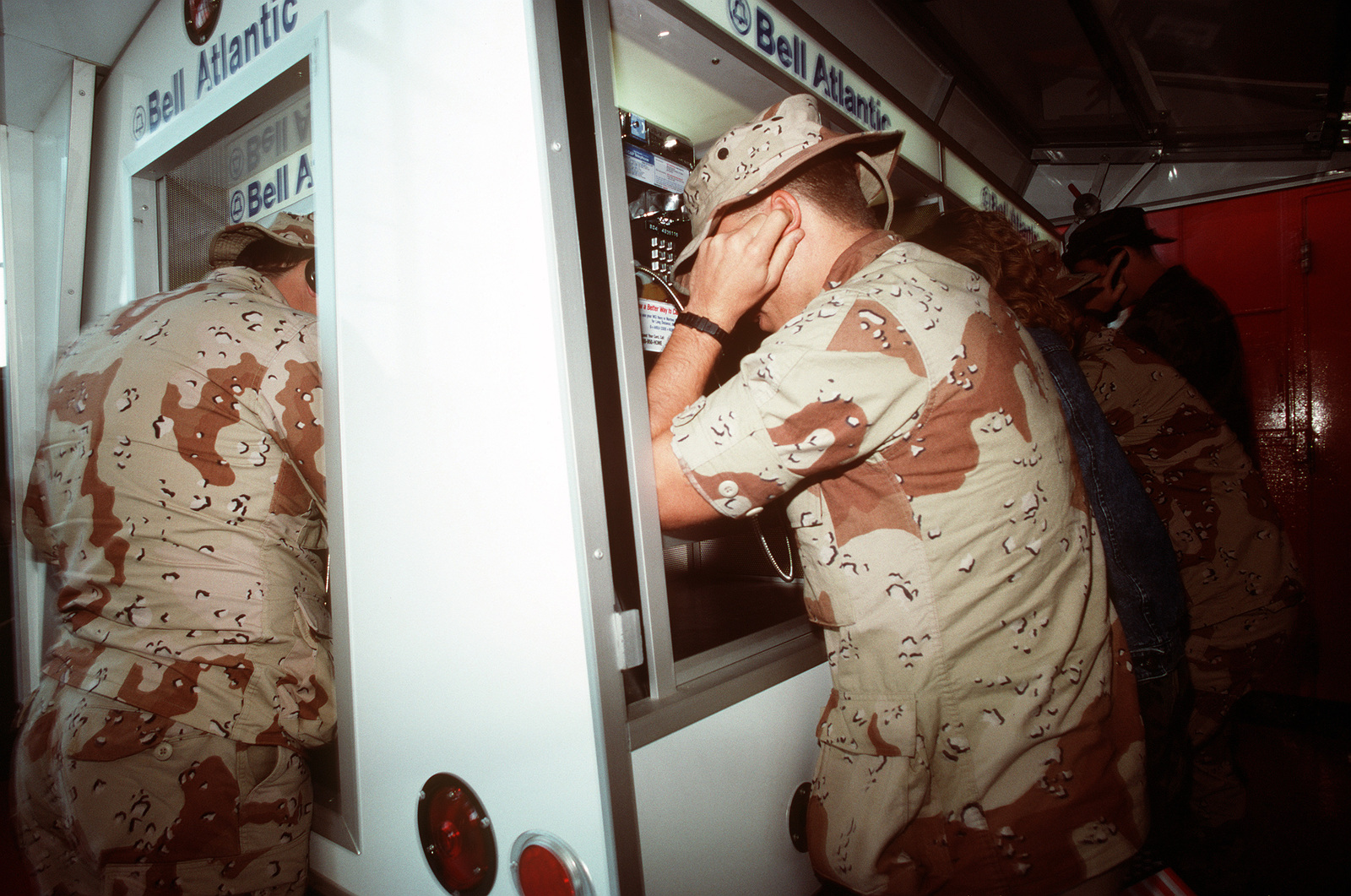 U.S. Navy beachmaster unit members telephone loved ones upon their arrival at Naval Air Station, Norfolk. The servicemen are returning from deployment in the Persian Gulf area during Operation Desert Storm