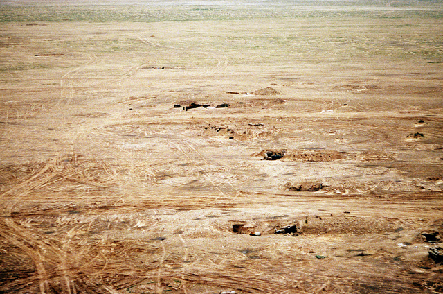 An aerial view of a section of Iraqi field fortifications abandoned during Operation Desert Storm