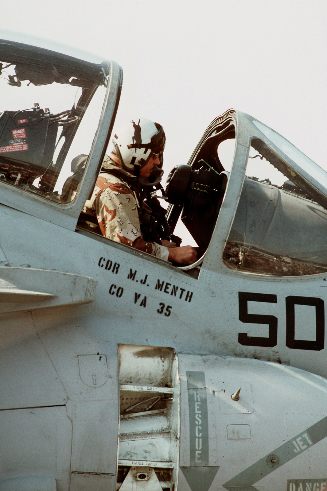 A bombardier/navigator sits in the cockpit of his Attack Squadron 35 (VA-35) A-6E Intruder aircraft following his return to the air station from the Persian Gulf along with other members of Carrier Air Wing 17 (CVW-17) and Carrier Air Wing 3 (CVW-3). The U.S. Navy personnel are being honored for their participation in Operation Desert Storm during homecoming ceremonies at the station