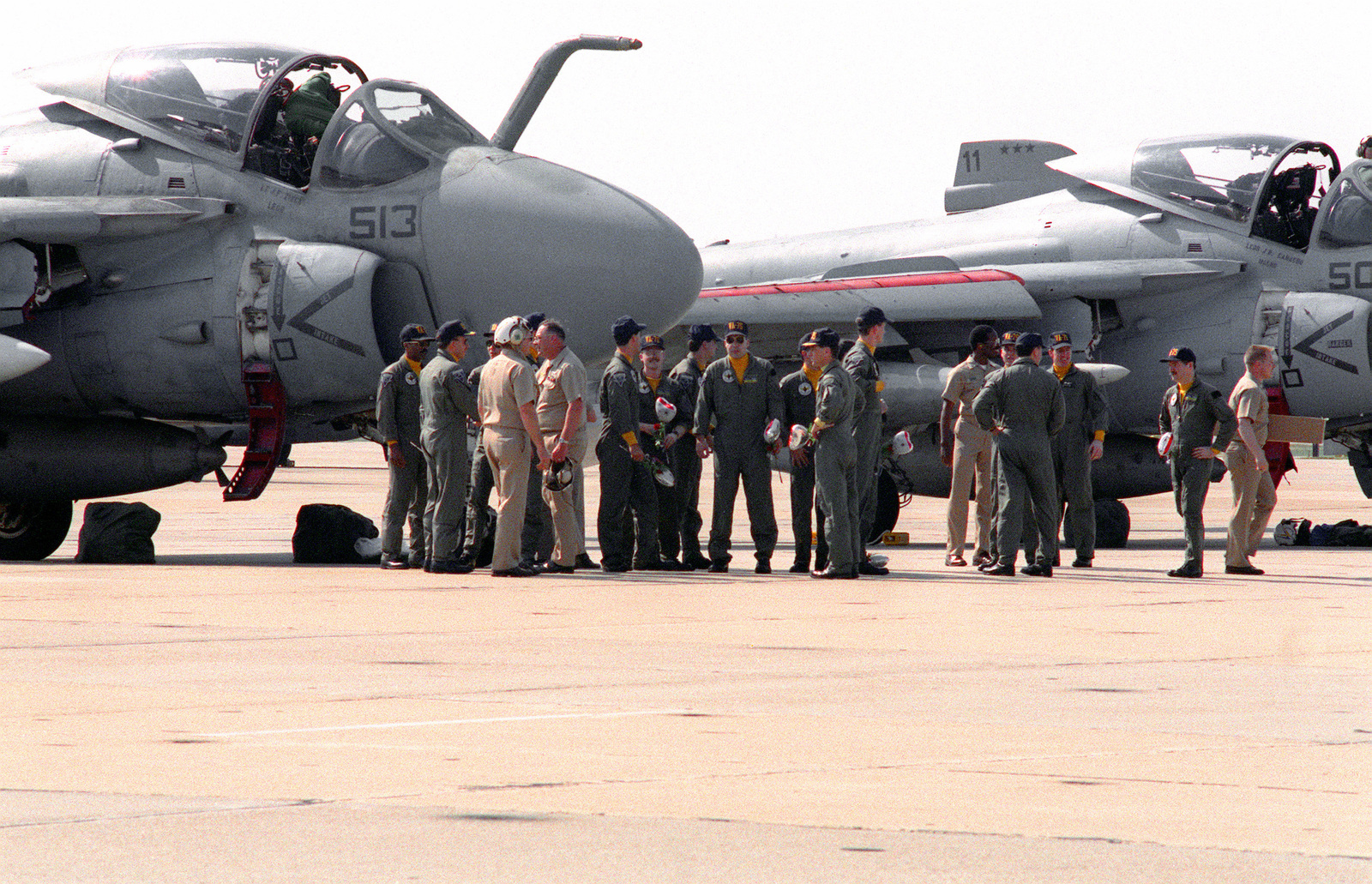 Attack Squadron 75 (VA-75) aviators gather near A-6E Intruder aircraft following their arrival on base. Carrier Air Wing 3 and Carrier Air Wing 17. Wing personnel have returned home after serving in the Persian Gulf during Operation Desert Storm