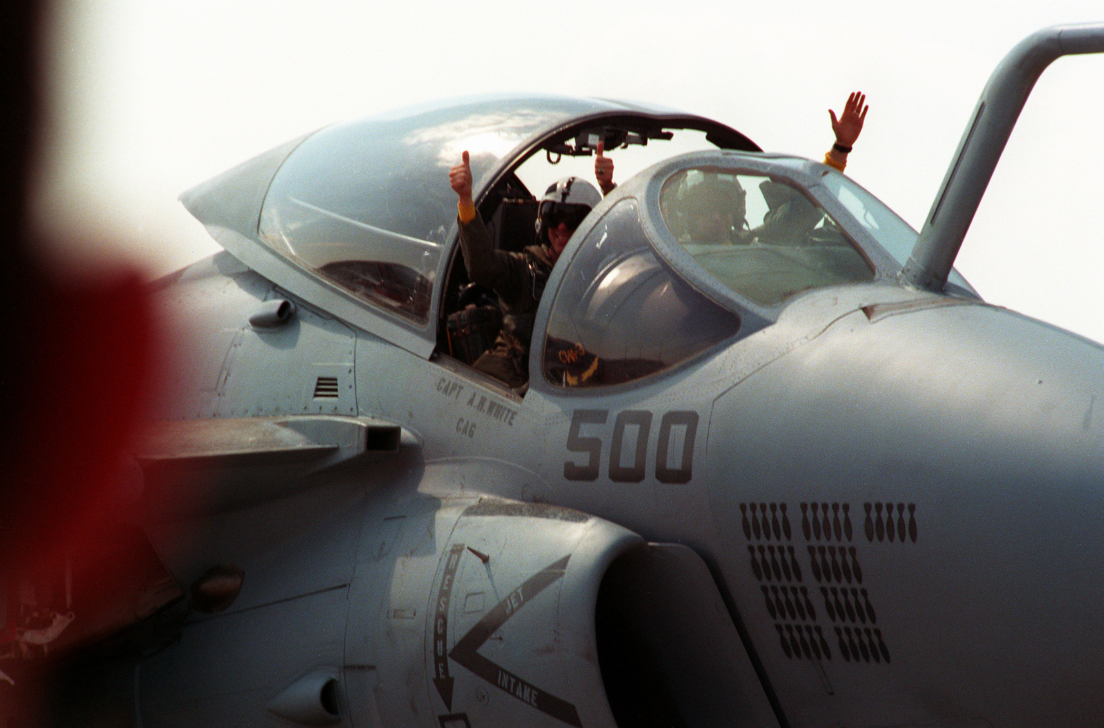 CAPT. A. Hardin White, the commander of Carrier Air wing 3 (CVW-3), waves from the bombardier-navigator's seat of an Attack Squadron 75 (VA-75) A-6E Intruder aircraft upon his arrival at the air station. VA-75 and the two fighter squadrons of CVW-3 are returning to Oceana following their deployment to the Persian Gulf region aboard the aircraft carrier USS JOHN F. KENNEDY (CV-67) for Operation Desert Shield and Operation Desert Storm