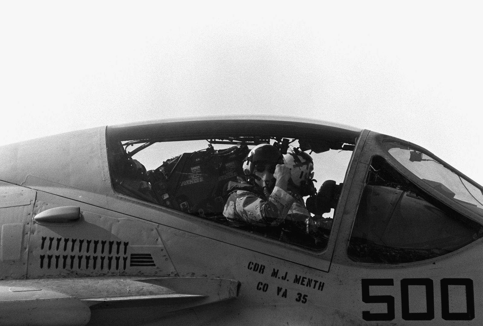 CMDR. Michael J. Menth, commanding officer of Attack Squadron 35 (VA-35), gestures to the awaiting crowd from the cockpit of his A-6E Intruder aircraft upon his arrival on base. Members of Carrier Air Wing 3 and Carrier Air Wing 17 are returning home after serving in the Persian Gulf during Operation Desert Storm