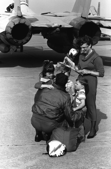 LT. CMDR. Rick Kurrus of Fighter Squadron 74 (VF-74) is reunited with his family upon his arrival on base. Members of Carrier Air Wing 3 and Carrier Air Wing 17 are returning home after serving in the Persian Gulf during Operation Desert Storm